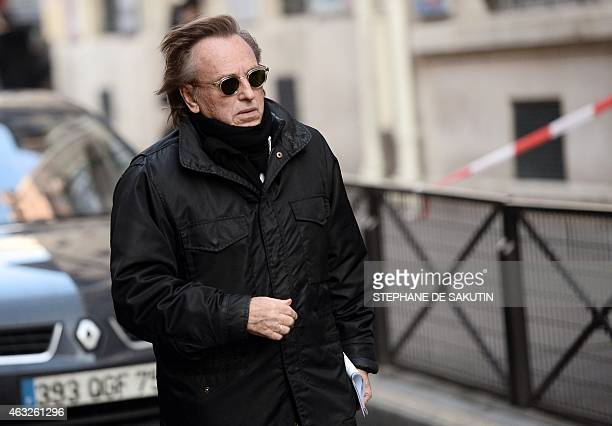 French film director Alexandre Arcady arrives at a synagogue on February 12 2015 in central Paris for a funeral ceremony in tribute to French actor...