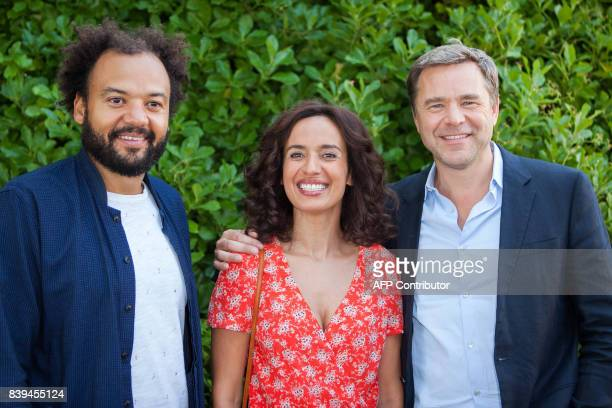 French film director and actor Fabrice Eboue French actress Amelle Chahbi and French actor Guillaume de Tonquedec pose during a photocall for the...
