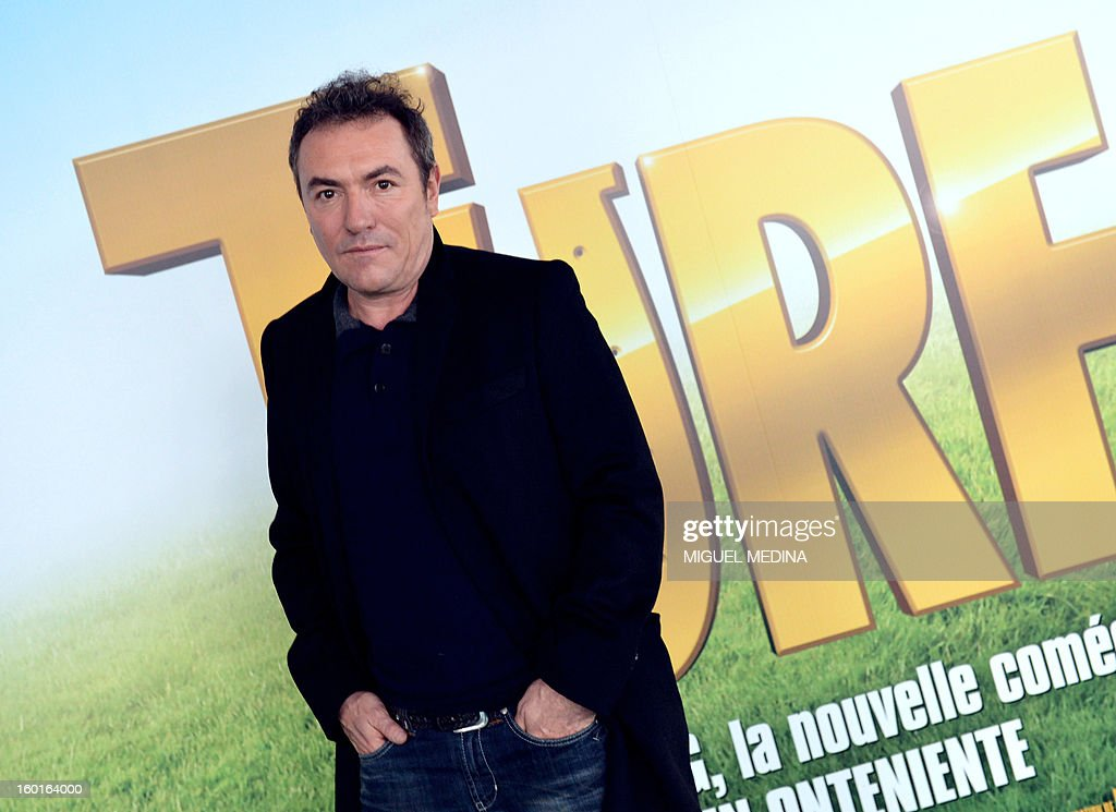 French film director and scriptwriter Fabien Ontoniente poses in front of his next film poster 'Turf' during the 92nd Prix d'Amerique, on January 27, 2013 at the Vincennes racetrack near Paris. The French movie Turf should be released in France on February 13, 2013.