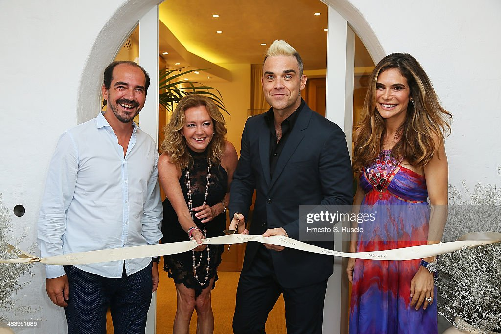Alexis Veller Caroline Scheufele Robbie Williams and Ayda Field attend the Chopard Boutique Inauguration at Piazzetta Del Cervo on August 13 2015 in...