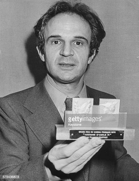 French film director Francois Truffaut holding his Grand Prix du Cinema award for 'La Nuit Americaine' Paris circa 1960