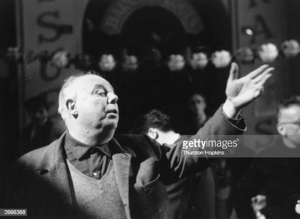 French film director Jean Renoir son of the Impressionist painter on the set of his latest film 'Elena Et Les Hommes' starring Ingrid Bergman...