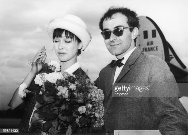 French film director JeanLuc Godard arriving at Berlin airport with his wife Danish actress Anna Karina 28th June 1961 The couple are in town for the...