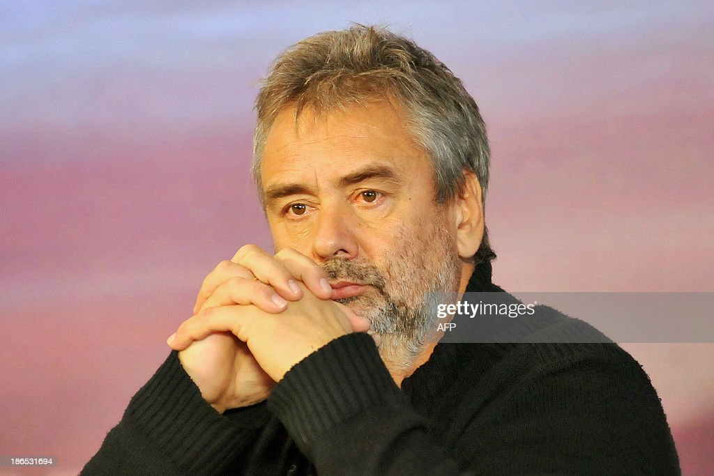 French film director Luc Besson listens at a press conference in Taipei on November 1, 2013. French director Luc Besson on November 1 rejected reports that his new movie 'Lucy' was about a drug mule and that he was ready to end shooting in Taipei after being harassed by paparazzi. AFP PHOTO / Mandy CHENG