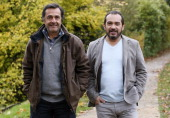 French film director Nicolas Vanier and French actor Mehdi El Glaoui pose on November 21 2013 in Paris ahead of the release of their film 'Belle et...
