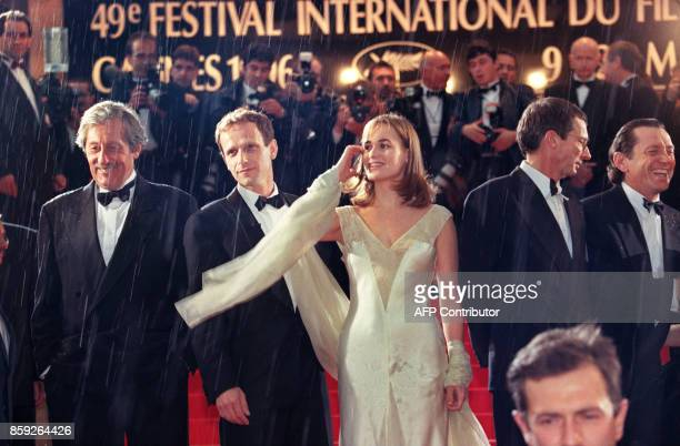 French film director Patrice Leconte accompanied by French actors Bernard Giraudeau Jean Rochefort Charles Berling and Judith Godreche arrive 09 May...