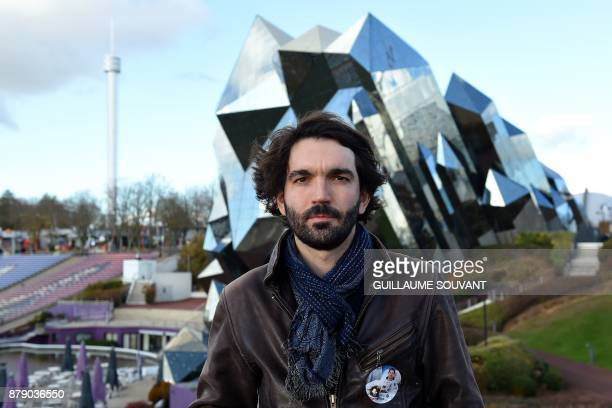 French film director PierreEmmanuel Le Goff poses on November 25 2017 in front of the Kinemax at the Futuroscope theme park in ChasseneuilduPoitou...