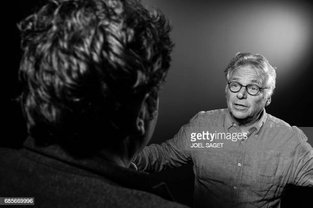 French film director Romain Goupil French and German former European parliamentarian and ecologist Daniel CohnBendit pose during a photo session in...