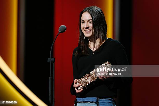 French film editor Mathilde Van de Moortel smiles after winning the Best Editing award for 'Mustang' during the 41st edition of the Cesar Ceremony at...