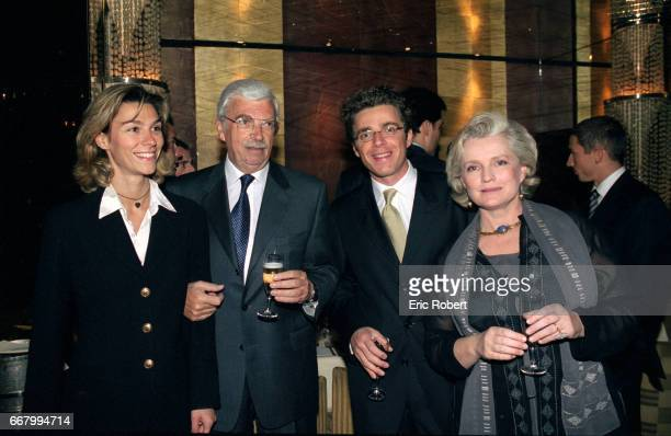 French film producer Daniel Toscan du Plantier poses with his exwife actress MarieChristine Barrault and their son David Toscan du Plantier at a...
