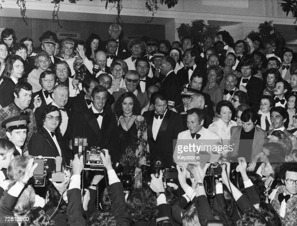 French film star JeanPaul Belmondo faces the photographers at the Cannes Film Festival with Italian actress Laura Antonelli after a screening of his...