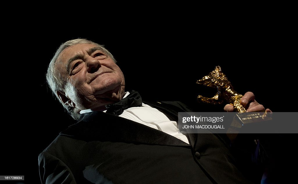 French filmmaker and journalist Claude Lanzmann holds his Honorary Golden Bear during a ceremony at the 63rd Berlinale Film Festival in Berlin February 14, 2013.
