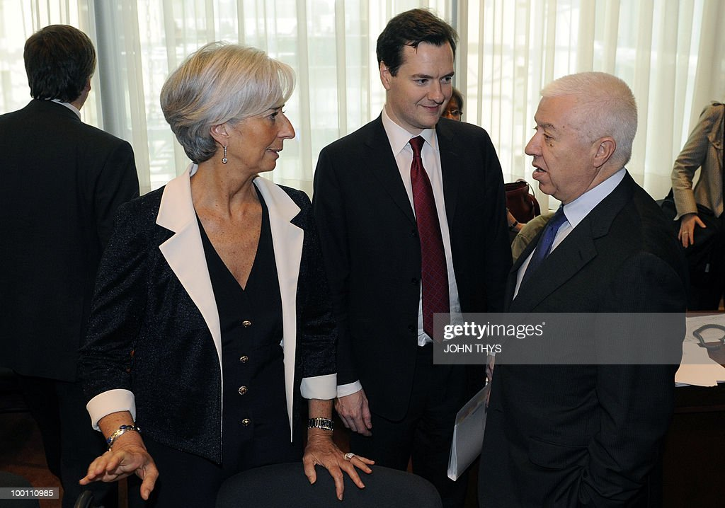 French Finance Minister Christine Lagarde speaks with British Chancellor of the Exchequer, George Osborne (C) and Portuguese Finance Minister Fernando Teixeira dos Santos (R) before a Economy Task Force meeting at the EU headquarters in Brussels on May 21, 2010. European ministers headed for landmark talks on curbing overspending Friday amid global turmoil over the eurozone debt crisis and signs of damage to economic recovery.