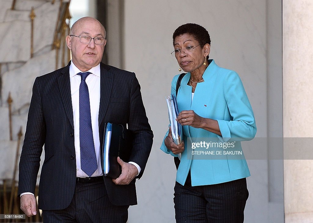 French Finance minister Michel Sapin and French minister for Overseas Territories George Pau-Langevin leave the Elysee presidential Palace after the weekly cabinet meeting in Paris on May 4, 2016.