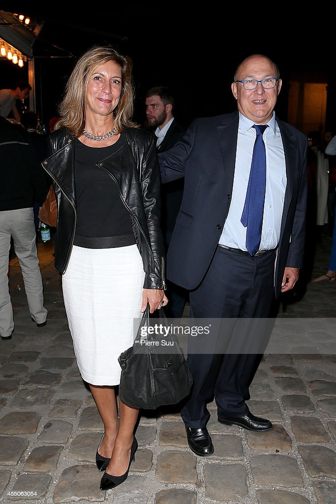 French Finance Minister <a gi-track='captionPersonalityLinkClicked' href=/galleries/search?phrase=Michel+Sapin&family=editorial&specificpeople=668944 ng-click='$event.stopPropagation()'>Michel Sapin</a> and his wife Valerie de Senneville attend 'Don Giovanni - Opera En Plein Air' at Hotel Des Invalides on September 9, 2014 in Paris, France.