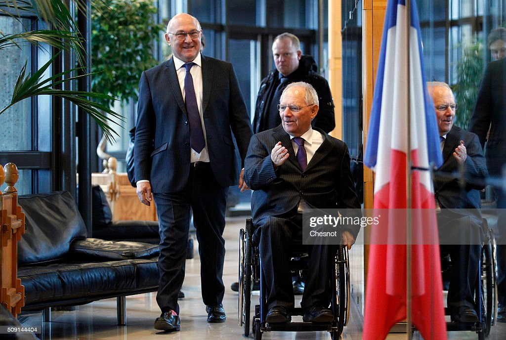 French Finance Minister <a gi-track='captionPersonalityLinkClicked' href=/galleries/search?phrase=Michel+Sapin&family=editorial&specificpeople=668944 ng-click='$event.stopPropagation()'>Michel Sapin</a> (L), arrives with German Finance Minister Wolfgang Schauble at the Ministry of Finance on February 9, 2016, in Paris, France. <a gi-track='captionPersonalityLinkClicked' href=/galleries/search?phrase=Michel+Sapin&family=editorial&specificpeople=668944 ng-click='$event.stopPropagation()'>Michel Sapin</a> meets Wolfgang Schauble for a Franco-German Economic and Financial Council meeting.