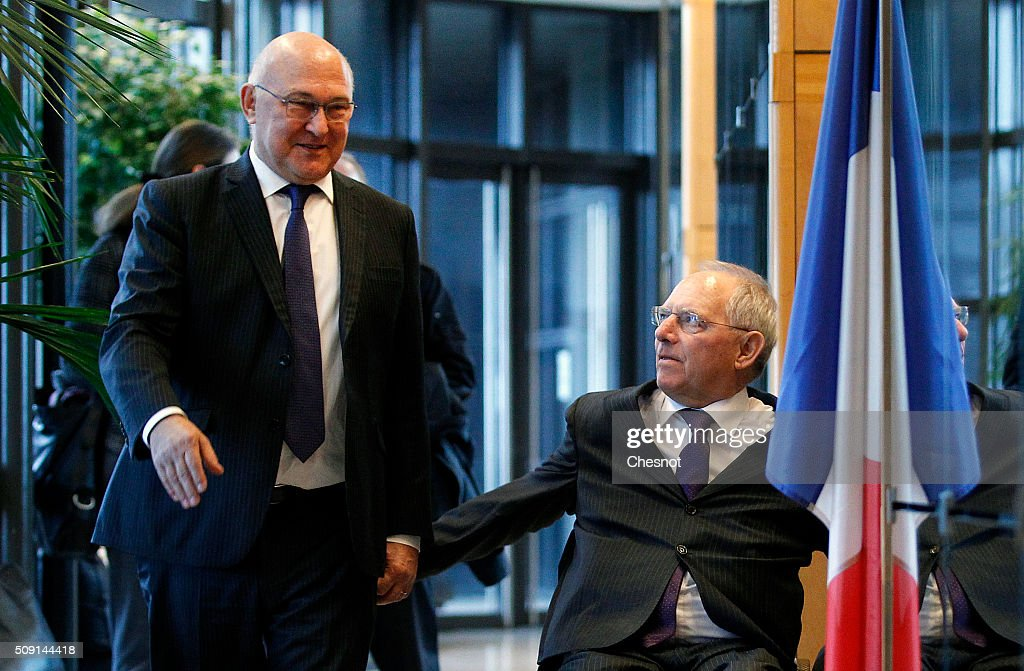 French Finance Minister Michel Sapin (L), arrives with German Finance Minister Wolfgang Schauble at the Ministry of Finance on February 9, 2016, in Paris, France. Michel Sapin meets Wolfgang Schauble for a Franco-German Economic and Financial Council meeting.
