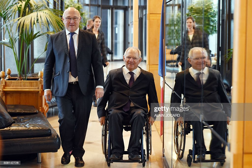 French Finance Minister Michel Sapin (L), arrives with German Finance Minister Wolfgang Schauble, for a Franco-German Economic Council, on February 9, 2016, in Villepinte, northeastern Paris. / AFP / ALAIN JOCARD