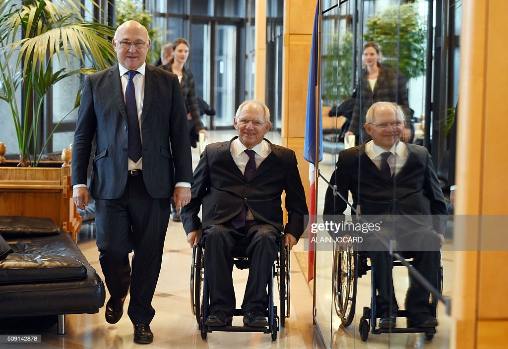 French Finance Minister Michel Sapin (L), arrives with German Finance Minister Wolfgang Schauble, for a France/Germany economic and finance summit, on February 9, 2016, in Paris.AFP PHOTO/ ALAIN JOCARD / AFP / ALAIN JOCARD