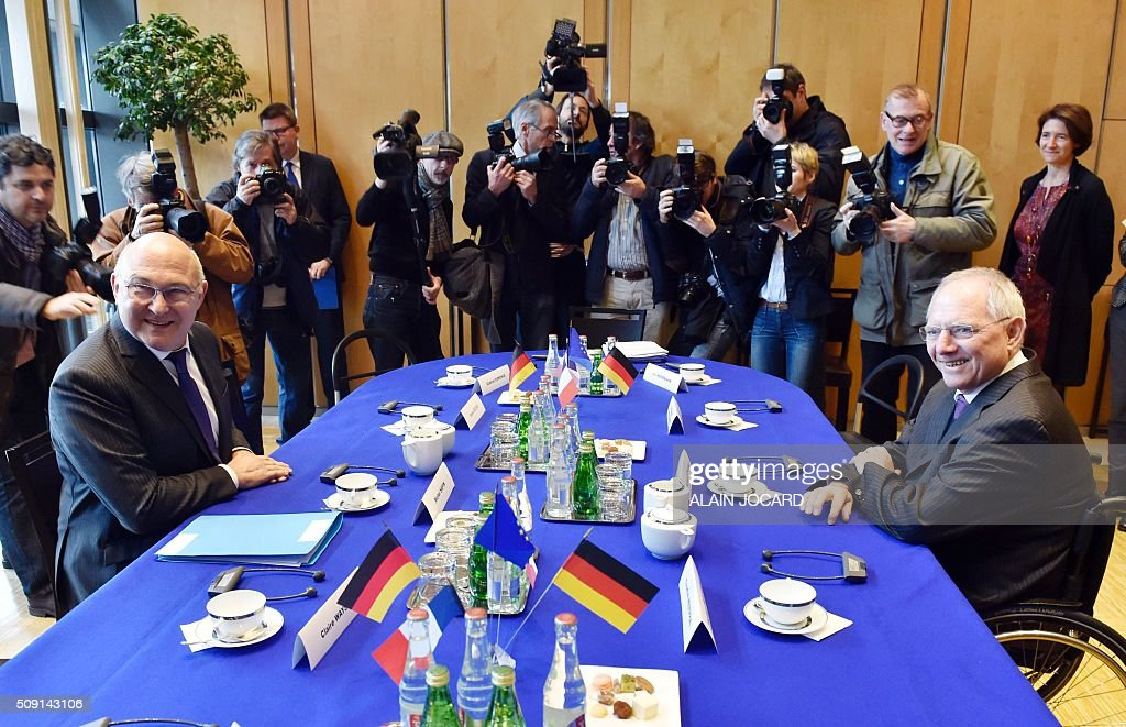 French Finance Minister Michel Sapin (L), meets with German Finance Minister Wolfgang Schauble during a Franco-German Economic Council, on February 9, 2016, in Villepinte, northeastern Paris. / AFP / ALAIN JOCARD