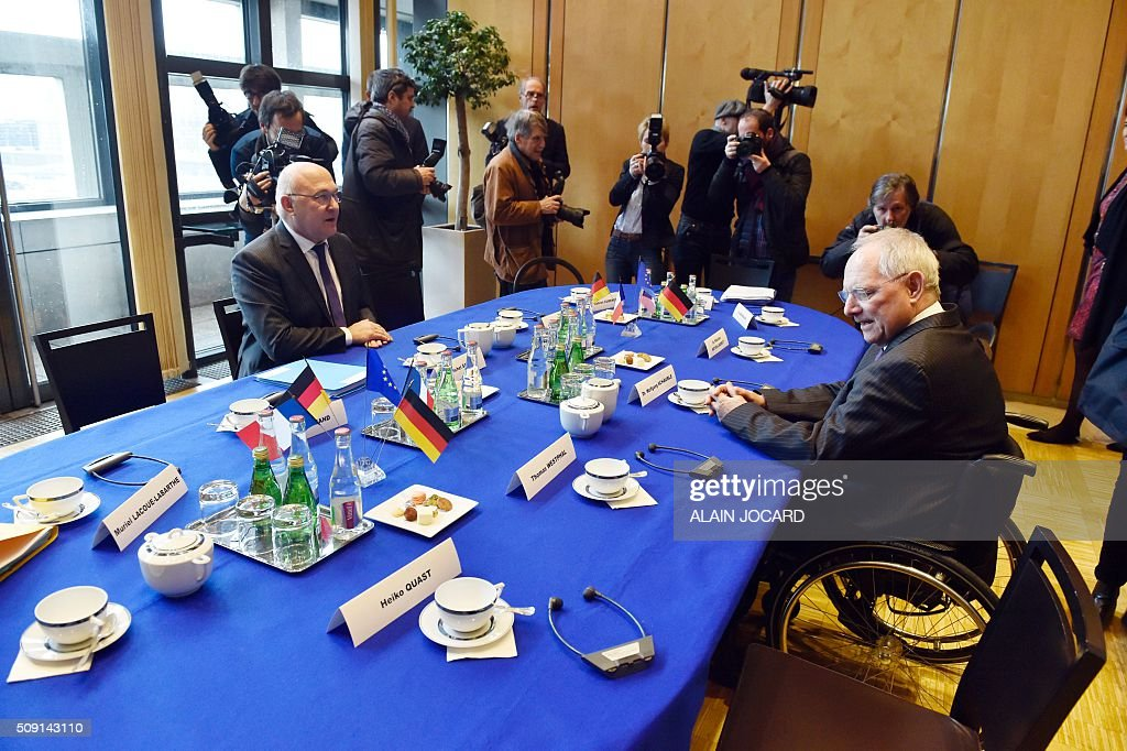 French Finance Minister Michel Sapin (L), meets with German Finance Minister Wolfgang Schauble during a Franco-German Economic Council, on February 9, 2016, in Paris. / AFP / ALAIN JOCARD