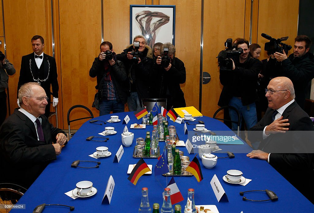 French Finance Minister Michel Sapin (R), poses with German Finance Minister Wolfgang Schauble prior a meeting at the Ministry of Finance on February 9, 2016, in Paris, France. Michel Sapin meets Wolfgang Schauble for a Franco-German Economic and Financial Council meeting.