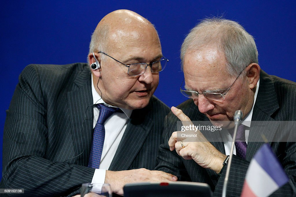 French Finance Minister <a gi-track='captionPersonalityLinkClicked' href=/galleries/search?phrase=Michel+Sapin&family=editorial&specificpeople=668944 ng-click='$event.stopPropagation()'>Michel Sapin</a> talks with German Finance Minister Wolfgang Schauble during a press conference at the French ministry of finances on February 9, 2016, in Paris, France. French Finance Minister, <a gi-track='captionPersonalityLinkClicked' href=/galleries/search?phrase=Michel+Sapin&family=editorial&specificpeople=668944 ng-click='$event.stopPropagation()'>Michel Sapin</a> meets German Finance Minister Wolfgang Schauble for a Franco-German Economic Council.