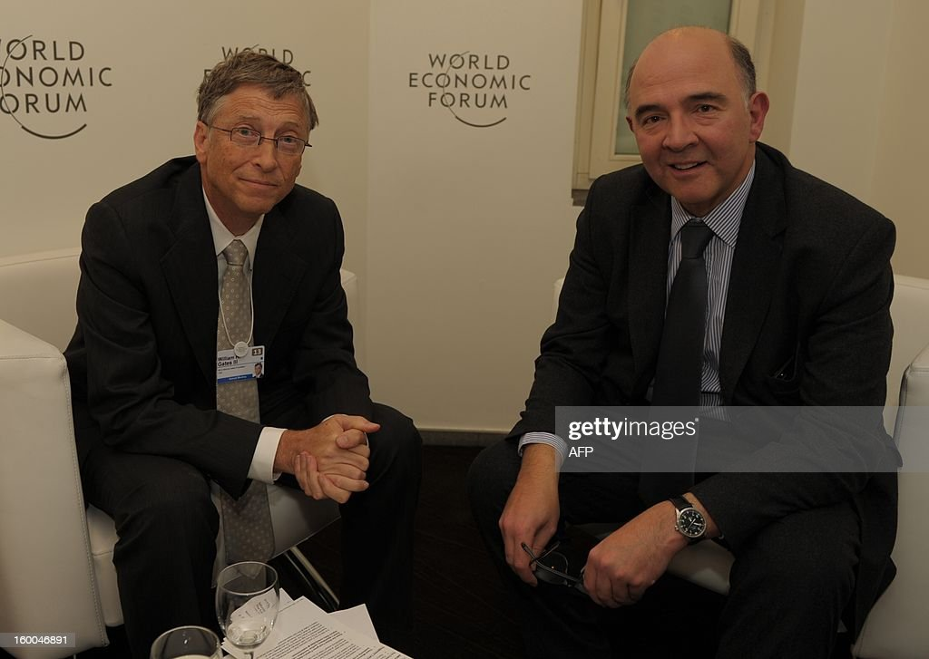 French Finance Minister Pierre Moscovici and Microsoft founder Bill Gates pose before a meeting on January 25 at World Economic Forum (WEF) meeting in the Swiss resort of Davos. The WEF will see top politicians and business leaders pursue talks on whether they have seen the back of the global financial crisis.