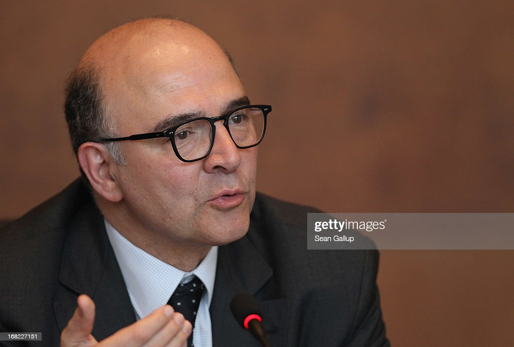 French Finance Minister <a gi-track='captionPersonalityLinkClicked' href=/galleries/search?phrase=Pierre+Moscovici&family=editorial&specificpeople=667029 ng-click='$event.stopPropagation()'>Pierre Moscovici</a> attends a discussion with students during events marking the 25th anniversary of the Franco-German Finance and Econimic Council on May 7, 2013 in Berlin, Germany. The Council was founded in 1988 to further not only economic relations between Germany and France but to create a further foundation for European economic stability.