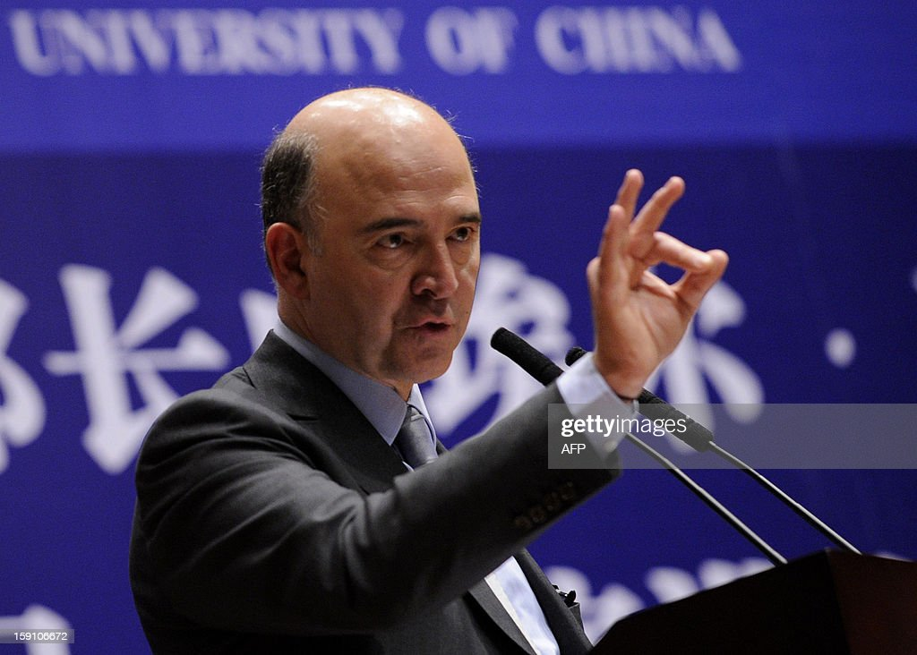 French finance minister Pierre Moscovici delivers a speech to students at Renmin University in Beijing on January 8, 2013. Moscovici began his two day visit to China on January 7.