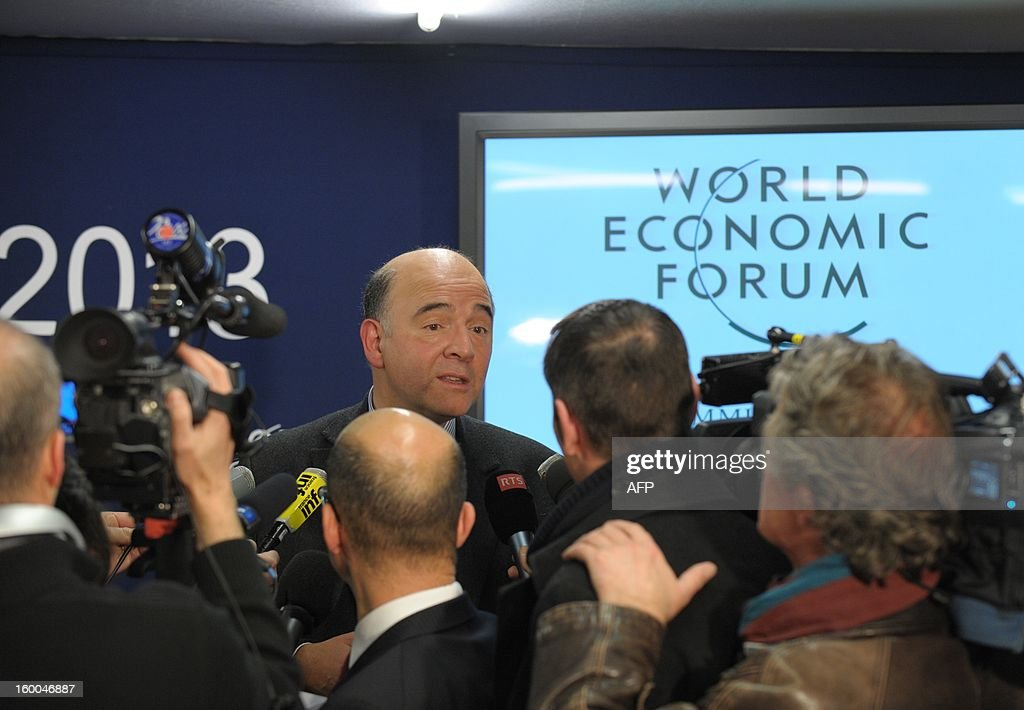 French Finance Minister Pierre Moscovici gives a press conference on January 25 at World Economic Forum (WEF) meeting in the Swiss resort of Davos. The WEF will see top politicians and business leaders pursue talks on whether they have seen the back of the global financial crisis. AFP PHOTO ERIC PIERMONT