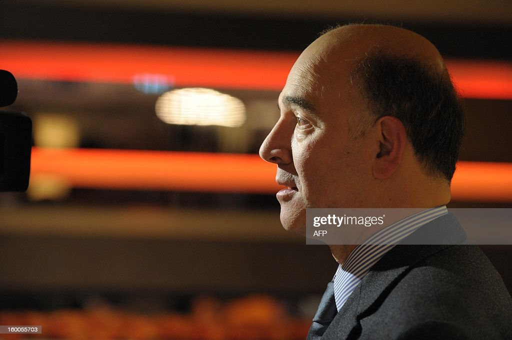 French Finance Minister Pierre Moscovici gives an interview on January 25 at the World Economic Forum (WEF) in the Swiss resort of Davos. The WEF will see top politicians and business leaders pursue talks on whether they have seen the back of the global financial crisis.