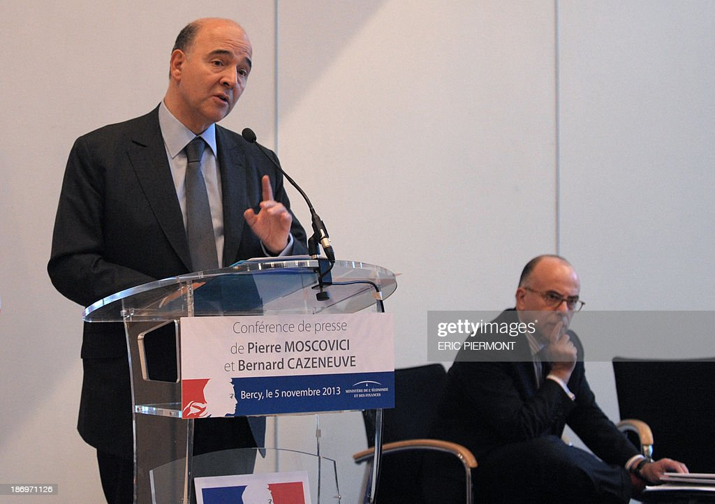 French Finance Minister Pierre Moscovici (L) talks as French Budget Minister Bernard Cazeneuve listens during a press conference on November 5, 2013 at the Economy Ministry in Paris. France will miss its agreed target to cut its public deficit to the EU's 3.0-percent threshold, the European Commission said on Tuesday, putting the 2015 shortfall at 3.7 percent. The French government deficit will hit 4.1 percent this year, according to EU figures, and will fall to 3.8 percent only next year.