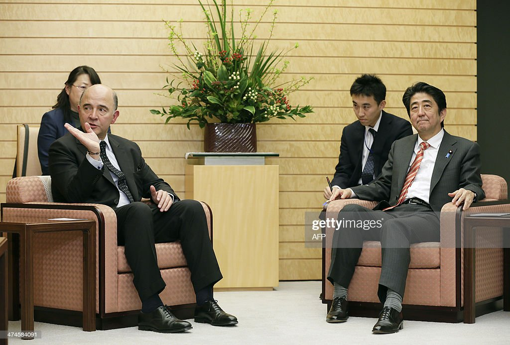 French Finance Minister <a gi-track='captionPersonalityLinkClicked' href=/galleries/search?phrase=Pierre+Moscovici&family=editorial&specificpeople=667029 ng-click='$event.stopPropagation()'>Pierre Moscovici</a> talks with Japanese Prime Minister Shinzo Abe (R) at the start of talks at the latter's official residence in Tokyo on 24 February, 2014. AFP PHOTO / KIMIMASA MAYAMA / POOL