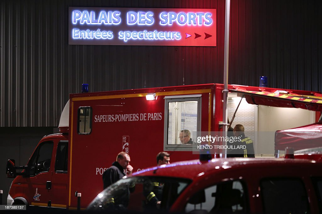 French firefighters arrive at the Palace of Sports at the Porte de Versailles in Paris following a blast on November 8, 2013. At least seven people were injured when an accidental explosion took place during a rehearsal of the musical '1789, The Lovers of Bastille'.