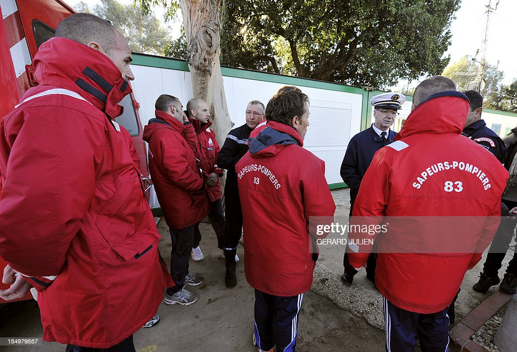 French firemen and policemen prepare on October 29, 2012 to search for a 12-year-old British boy, who disappeared on October 27, on Porquerolles island, southeastern France. Sixty soldiers and three civil security dog-handlers from Brignoles are paricipating in the search. AFP PHOTO GERARD JULIEN