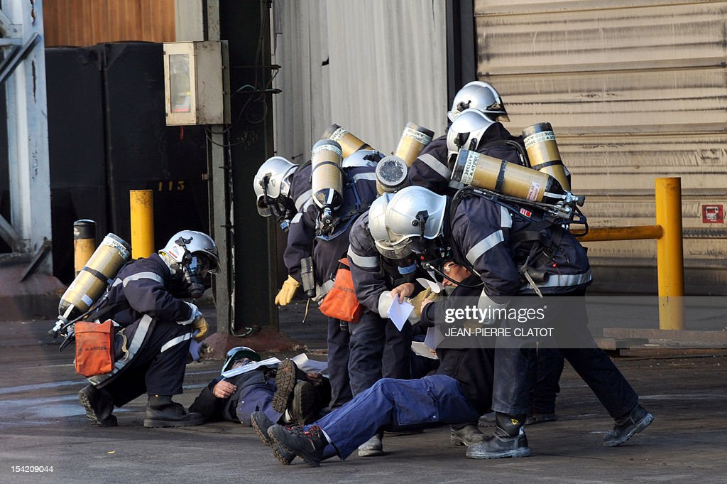 French firemen are seen during a security exercice in Jarrie, southeastern France inside the Jarrie site of CEZUS, an AREVA group subsidiary and a global leader in the market for nuclear-grade zirconium. Zirconium is a metal used for fuel cladding, among other applications. The CEZUS Jarrie plant site produces zirconium sponge through a series of chemical operations and extractive metallurgy. It also recovers the by-products of zirconium manufacturing , such as hafnium, magnesium and silicon salts and oxides. AFP PHOTO / JEAN-PIERRE CLATOT