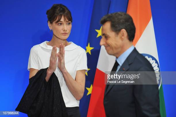 French first lady Carla BruniSarkozy and French President Nicolas Sarkozy attend a tribute to the victims to the Mumbai terror attack held at the...