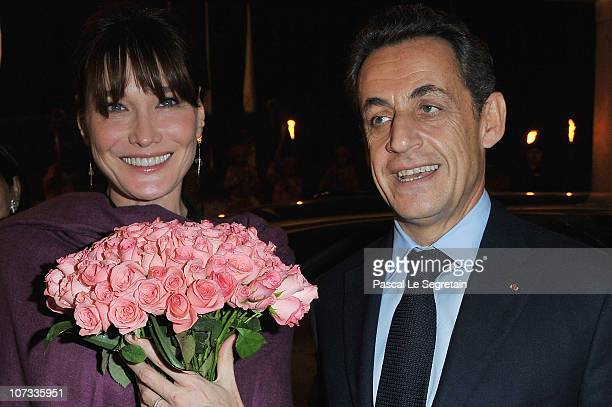 French first lady Carla BruniSarkozy and French President Nicolas Sarkozy arrive at the Taj Mahal Palace Hotel on December 5 2010 in New Delhi India...
