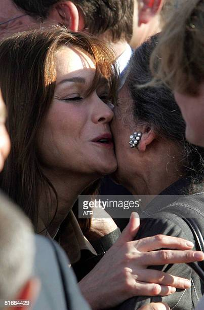 French First Lady Carla BruniSarkozy kisses French philosopher and Holocaust survivor Simone Weil during a welcoming ceremony for French President...