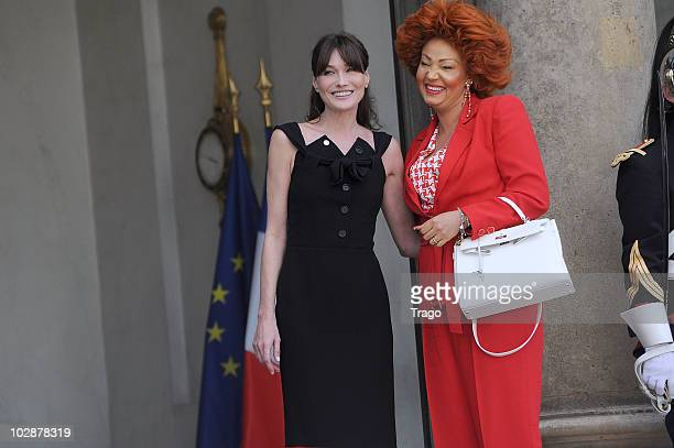 French First Lady Carla BruniSarkozy welcomes Cameroun's First Lady Chantal Biya on July 13 2010 at the Elysee Palace in Paris