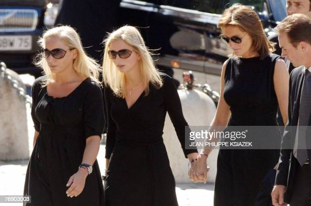 French first lady Cecilia Sarkozy arrives with her daughters Judith and JeanneMarie at the cathedral of Lyon 20 September 2007 for the funeral of her...