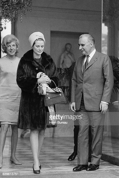 French First Lady Claude Pompidou Princess Grace of Monaco and French President Georges Pompidou leave the Elysee Palace during the visit of the...