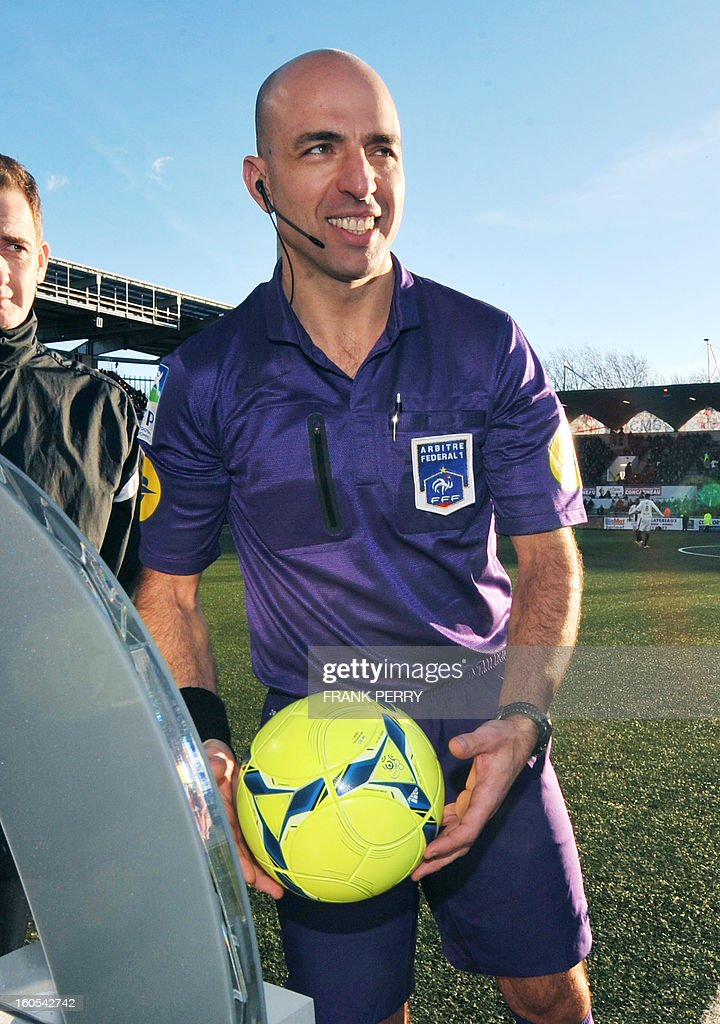 French first referee Bartolomeu Varela enters the field before the start of the French L1 football match Lorient (FCLBS) vs Rennes (SRFC) , on February 2, 2013 at the Moustoir Stadium in Lorient, western France.