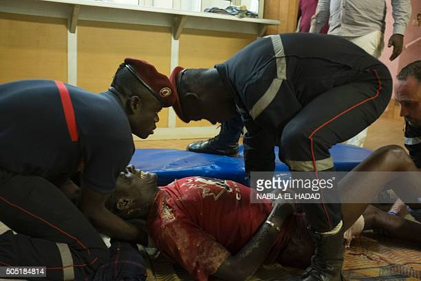 French first responders tend to wounded people in the surrounding of the hotel Splendide and the café Cappuccino during the attack on January 15 2016...