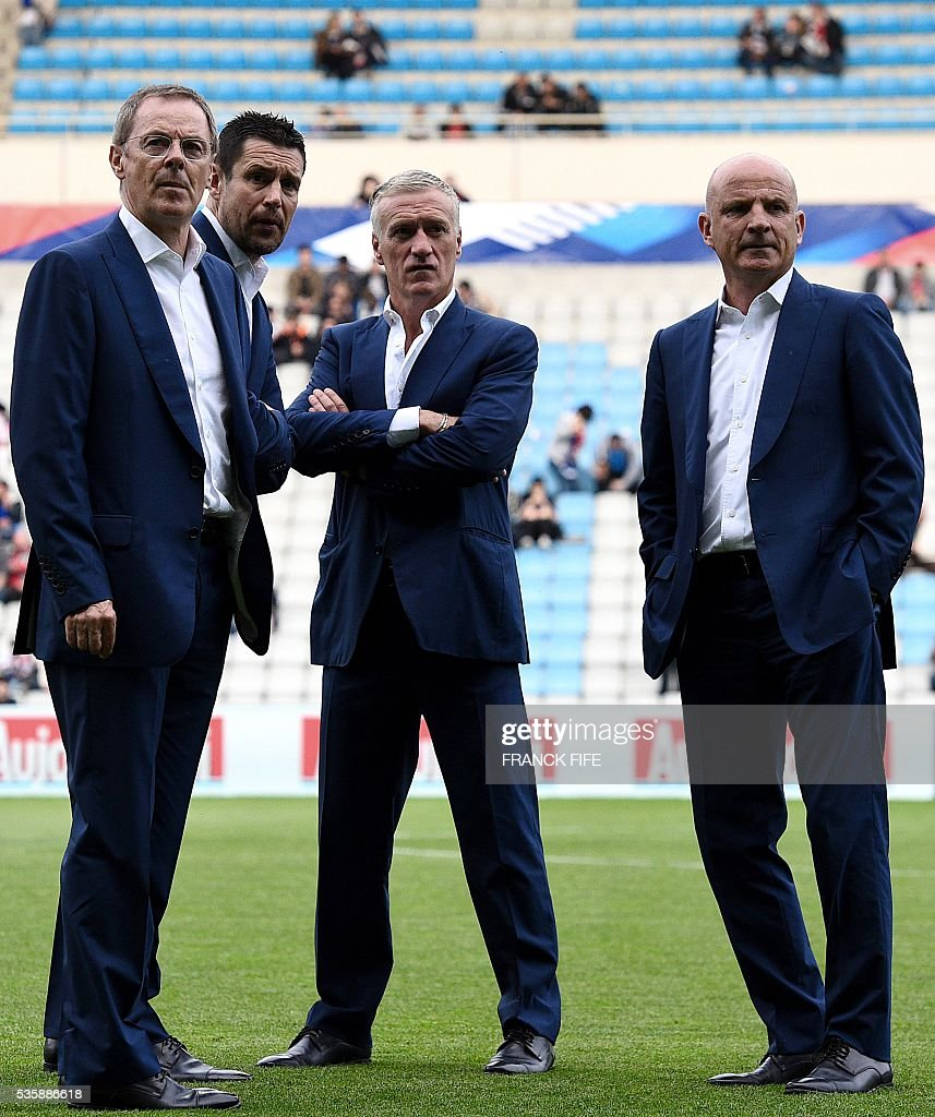 French fitness coach Eric Bedouet, goalkeeper coach Franck Raviot, head coach Didier Deschamps and assistant coach Guy Stephan look on prior to the friendly football match between France and Cameroon, at the Beaujoire Stadium in Nantes, western France, on May 30, 2016. / AFP / FRANCK