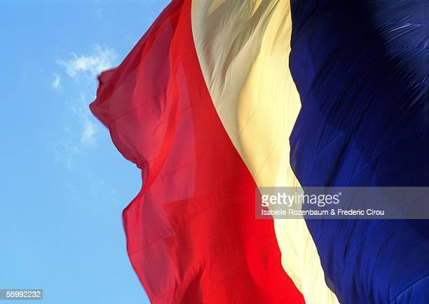 French flag blowing in wind, close-up