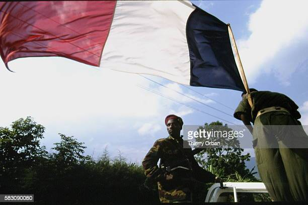 A French flag flies from a Rwandan forces vehicle At this moment Rwandan soldiers were persuaded that the French had come to support the Hutu army...