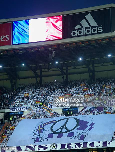 French flag is displayed on a screen before the Spanish league 'Clasico' football match Real Madrid CF vs FC Barcelona at the Santiago Bernabeu...