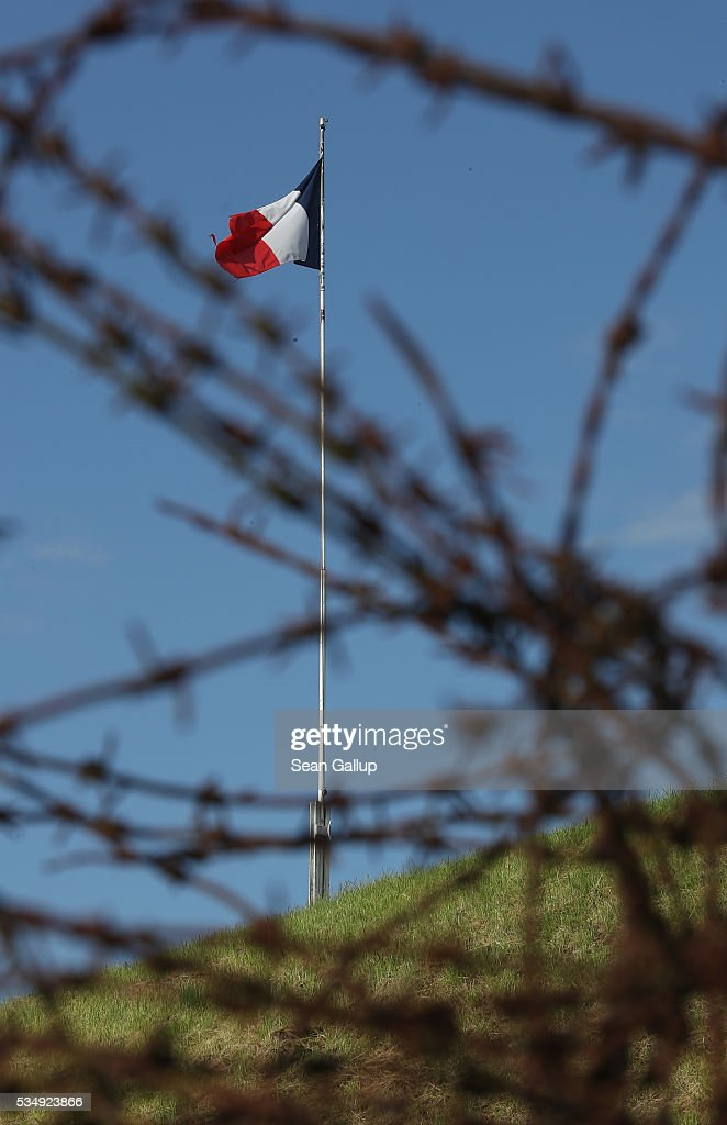 A French flag is seen through barbed wire standing at the ruins of Fort Troyon, one of the many forts used by the French to defend the region around Verdun during World War I, on May 28, 2016 near Verdun, France. The governments of France and Germany will commemorate the 100th anniversary of the World War I Battle of Verdun with ceremonies tomorrow. Approximately 300,000 soldiers lost their lives in the 10-month campaign that was among the most grueling battles of World War I.